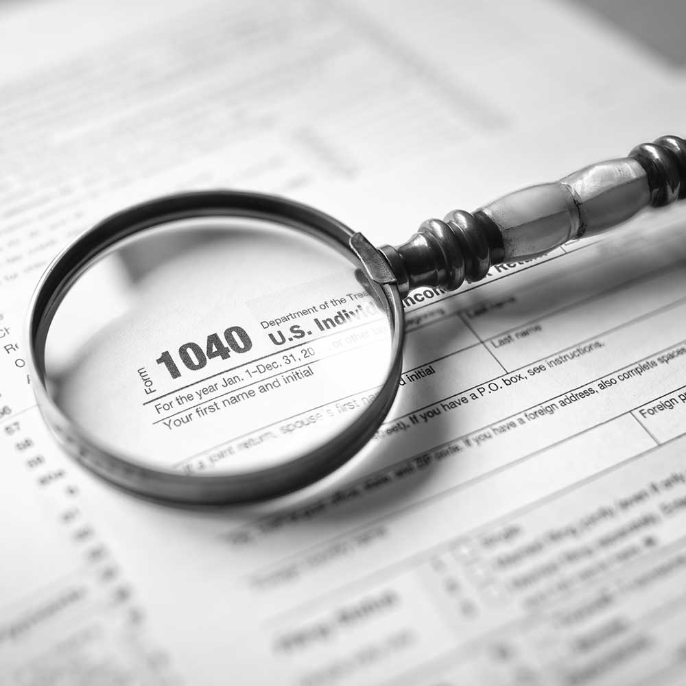income tax form and magnifying glass
