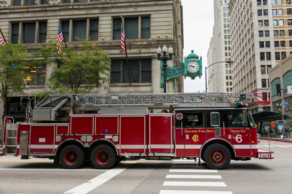 A red fire truck on the street  Description automatically generated with medium confidence